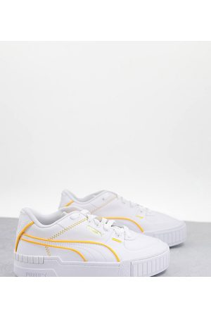 PUMA Cali Sport trainers in white with neon orange piping