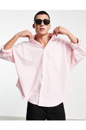 ASOS Volume oversized dad shirt in pastel pink