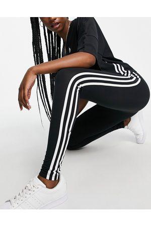 adidas Adicolor three stripe logo leggings in black