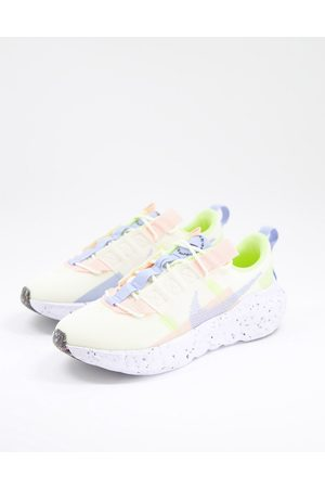 Nike Crater Impact trainers in off white yellow and blue