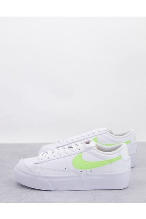 Nike Blazer Platform low trainers in white and yellow