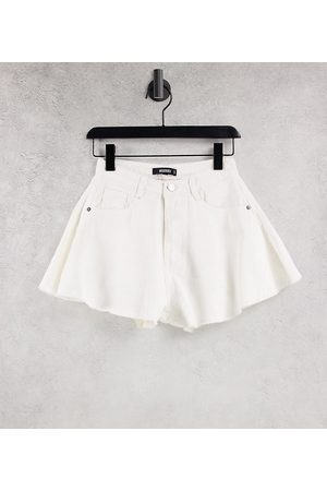 Missguided Denim mom shorts with raw hem in white