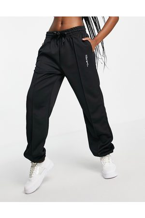 Nike Oversized joggers in black with drawcord