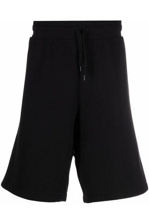 Moschino Pantalones joggers con logo bordado
