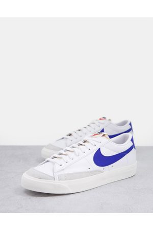 Nike Blazer Low '77 trainers in white and blue