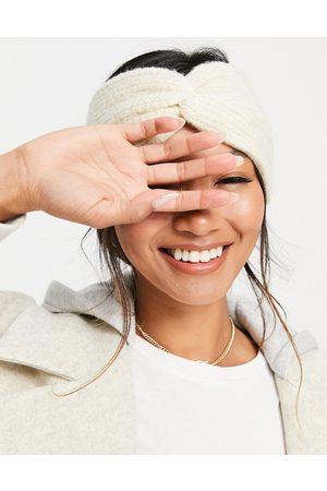 ASOS DESIGN Twist front textured knit headband in cream