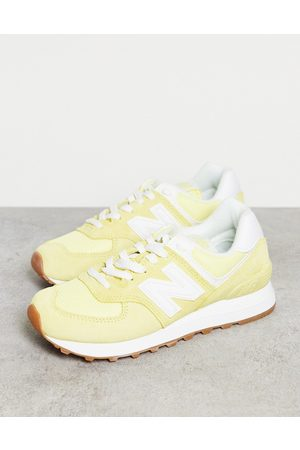 New Balance 574 trainers in yellow