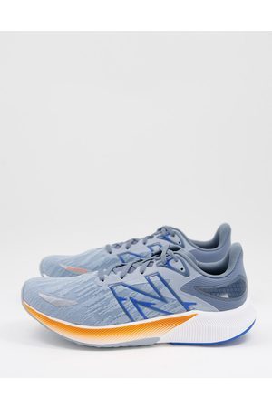 New Balance FuelCell Proper V2 trainers in blue and orange
