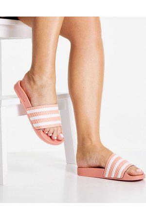 adidas Originals Adilette sliders in blush