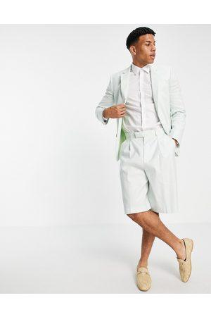 ASOS DESIGN Wide leg bermuda shorts in pastel green cotton linen