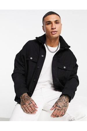 ASOS DESIGN Oversized denim jacket with detachable borg collar in black