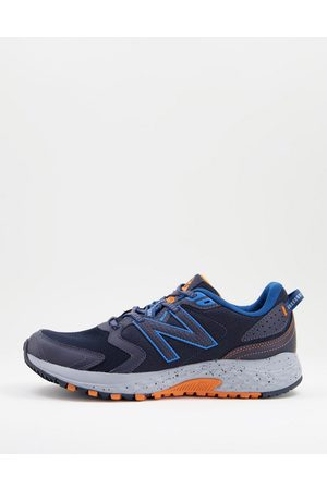 New Balance Trail 410 trainers in blue and grey
