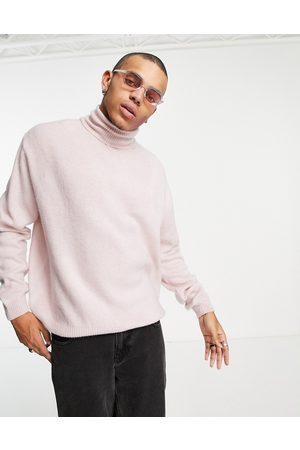ASOS DESIGN Fluffy knit roll neck jumper in pink