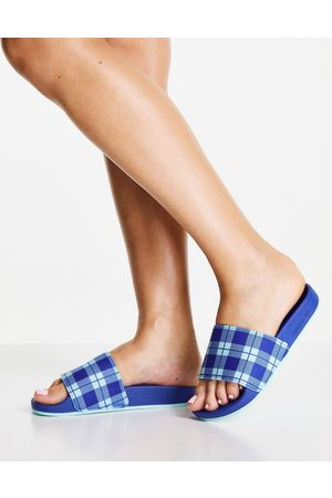 adidas Mujer Flip flops - Adilette terry towelling sliders in blue with check print