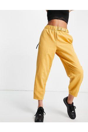 Nike Woven trouser in gold yellow