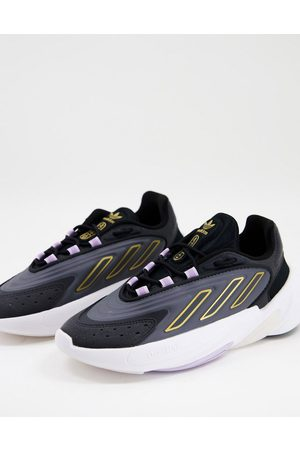 adidas Originals Ozelia trainers in black with yellow detail