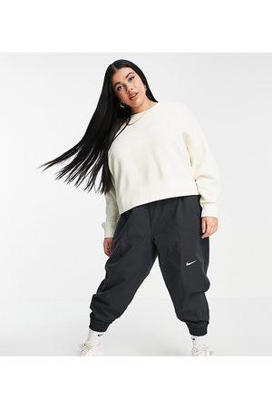 Nike Plus mini swoosh oversized boxy sweatshirt in off white