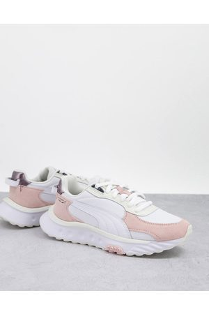 Puma Mujer Tenis - Wild Rider trainers in off white and pastel pink
