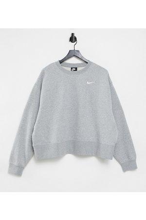 Nike Plus mini swoosh oversized boxy sweatshirt in grey