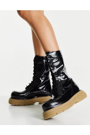 ASOS Alicia premium leather chunky lace up boots in black with beige sole