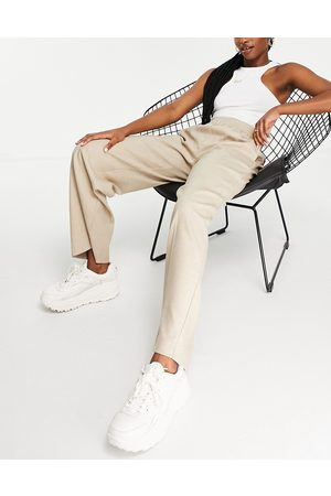 SELECTED Femme recycled wide leg trousers with front crease and elasticated waist in sand