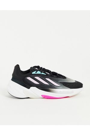 adidas Ozelia trainers in black and white
