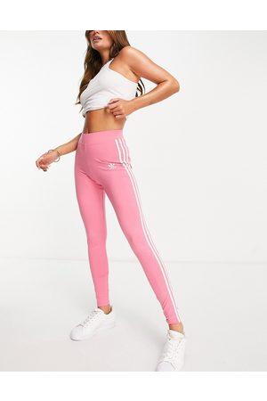 adidas Adicolor three stripe logo leggings in pink