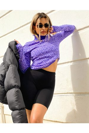 ASOS Roll neck jumper with logo print in purple