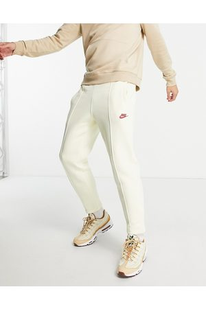 Nike Club tapered fit joggers in coconut milk