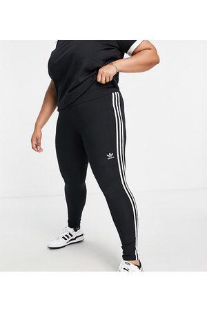 adidas Plus three stripe leggings in black