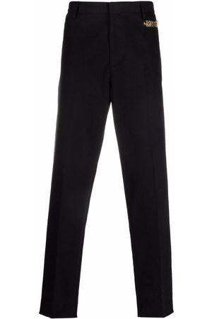 Moschino Pantalones de vestir con logo