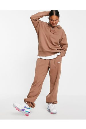 Nike Oversized fleece jogger in earth brown