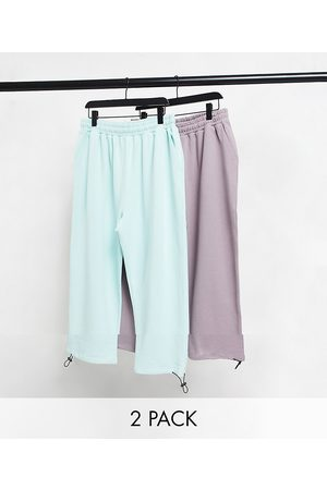 ASOS DESIGN 2 pack super oversized joggers with toggle bottom in blue/purple