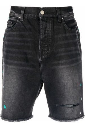 AMIRI Pantalones vaqueros cortos con efecto de salpicadura de pintura