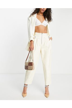 Ghospell Faux leather trousers in cream