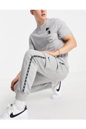 Nike Repeat taping fleece cargo joggers in grey