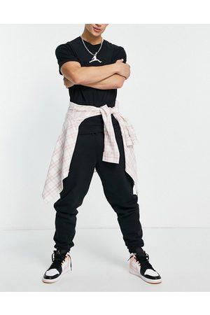 Jordan Hombre Joggers - Nike fleece jogger in black
