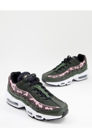 Nike Air Max 95 trainers in green and pink leopard print