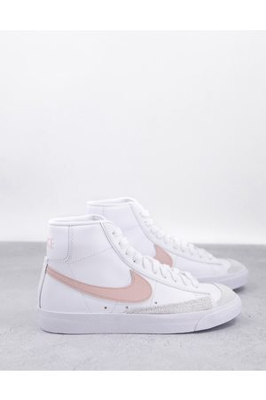 Nike Blazer Mid 77 trainers in white and coral