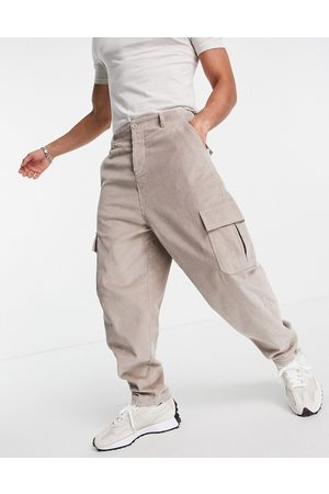 ASOS DESIGN Oversized tapered fit trousers with cargo pockets in cord