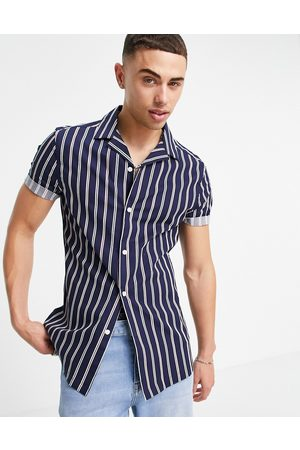 ASOS DESIGN Skinny shirt in navy stripe and roll sleeve