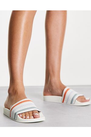 adidas Originals Adilette terry towelling sliders in white off with coloured three stripes
