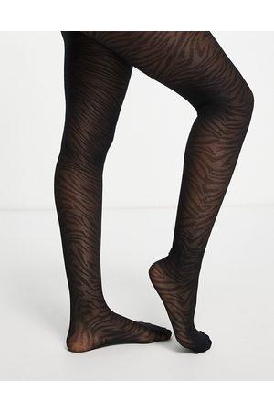 ASOS DESIGN 30 denier zebra print tights in black
