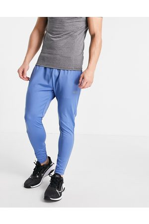 ASOS 4505 Icon super skinny training joggers with quick dry in blue
