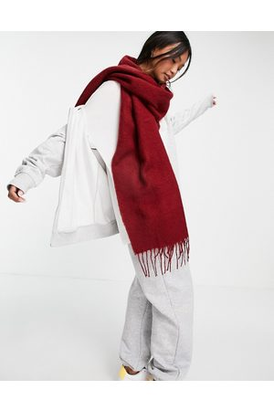 ASOS DESIGN Supersoft scarf with tassels in deep red