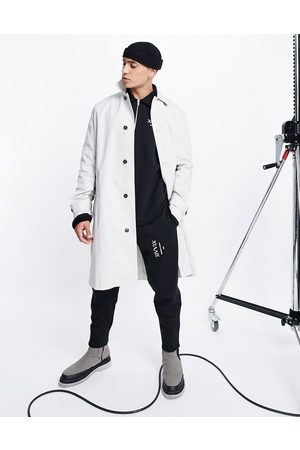 ASOS DESIGN Relaxed fit ecru trench coat with check panel details