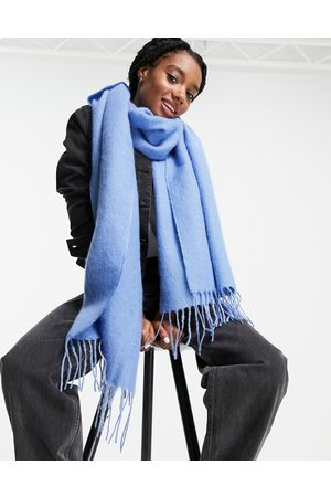 ASOS DESIGN Supersoft long woven scarf with tassels in blue