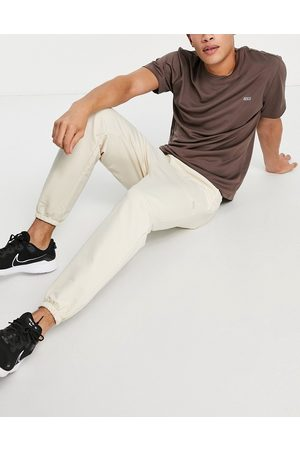 ASOS Icon training jogger with tapered fit in stone