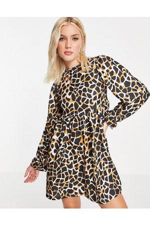 ASOS Oversized long sleeve mini smock dress in large scale giraffe print