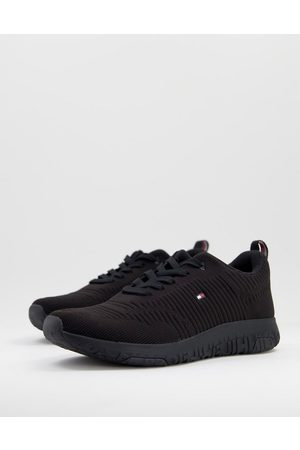 Tommy Hilfiger Knit runner trainer with small flag logo in black